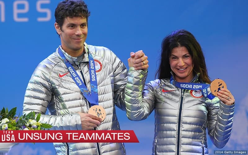 Rob Umstead and Danelle Umstead hold hands on podium at 2014 Paralympics.