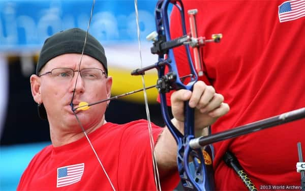 Paralympic archer Jeff Fabry prepares to shoot in competition