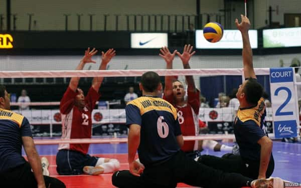 James Stuck blocks against Brazil at the 2010 Sitting Volleyball World Championships