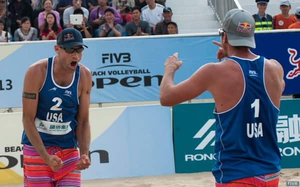 Phil Dalhausser, left, and Sean Rosenthal celebrates during the gold medal match
