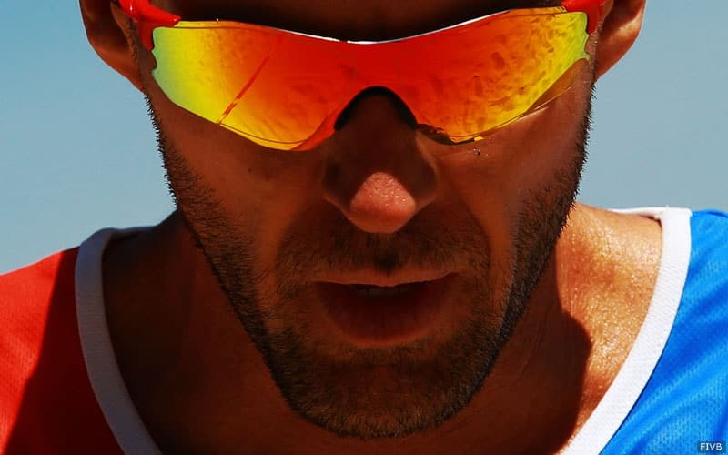 Jake Gibb in sunglasses during a beach volleyball match 2017