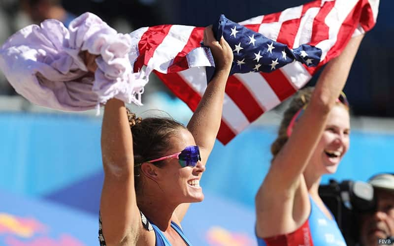 Brooke Sweat and Summer Ross hold the U.S. flag