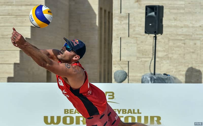 Phil Dalhausser dives for the ball