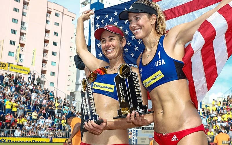 April Ross and Alix Klineman with the U.S. flag