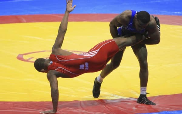 Burroughs of USA in the wrestling men's freestyle 74 kg match during the 2011 XVI Pan American Games at CODE II Gym