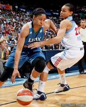 Moore #23 of the Minnesota Lynx drives against Armintie Price #22 of the Atlanta Dream in Game Three of the 2011 WNBA Finals