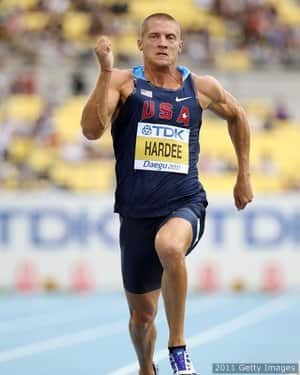 Hardee of United States competes in the 100 metres in the men's decathlon