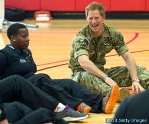 Prince Harry plays volleyball with the British Armed Forces team